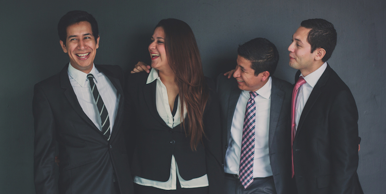 coworkers-in-suits-laughing
